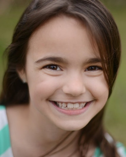 A young girl who has received Savannah orthodontics care